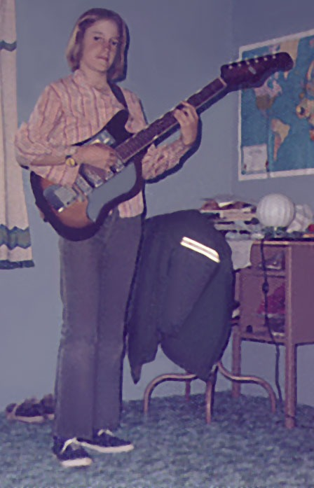 12-Year-Old Michael in room with guitar